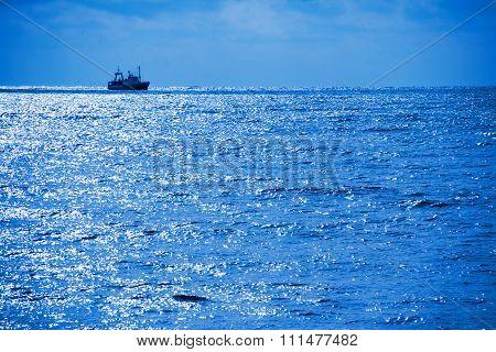 fishing boat on a moonlit night