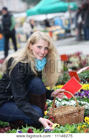 Young, Blonde  Buys Cheerful Flowers