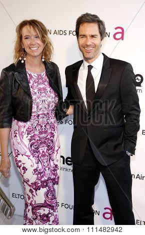 Eric McCormack and Janet Holden at the 21st Annual Elton John AIDS Foundation Academy Awards Viewing Party held at the Pacific Design Center in West Hollywood on February 24, 2013.