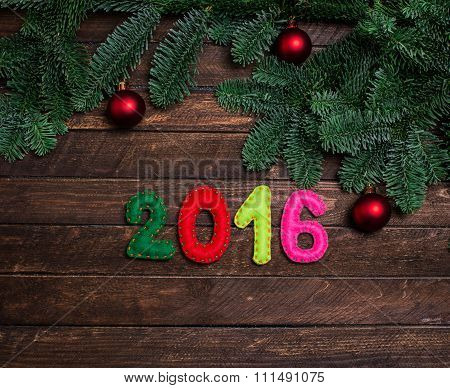 Childish New Year Background With Christmas Toy From Felt On Dark Rustic Wooden Background. Holiday