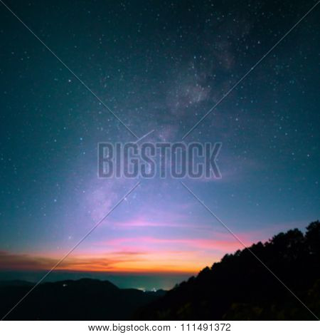 Abstract Blurred Milky Way And Stars At Night With Vintage Tone.