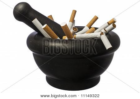 Quit Smoking - Pestle With Cigarettes Isolated Over White