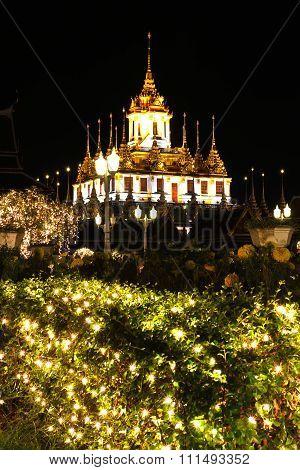 Loha Prasat Metal Palace In Wat Ratchanadda At Night, Bangkok, Thailand