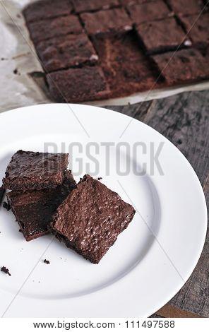White plate of fresh chocolate brownies