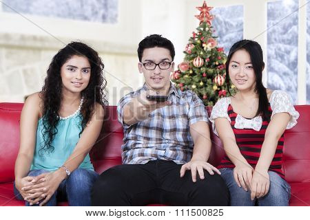 Multiracial People Watching Tv At Home