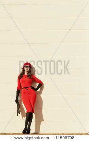 woman in red dress about the wall