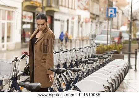 Winter Dressed Woman Near City Bike
