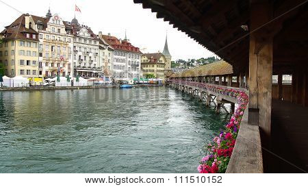LUCERNE, SWITZERLAND- JUNE 13, 2015: Chapel Bridge. Inside the bridge are a series of paintings from