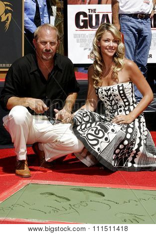 09/06/2006 - Hollywood - Kevin Costner and Christine Baumgartner attend the Kevin Costner Hand and Footprints Ceremony held at the Grauman's Chinese Theater in Hollywood, California, United States.