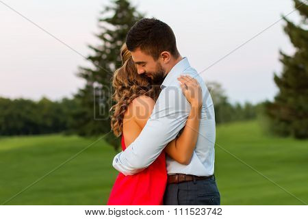 Couple in love passionately hug.