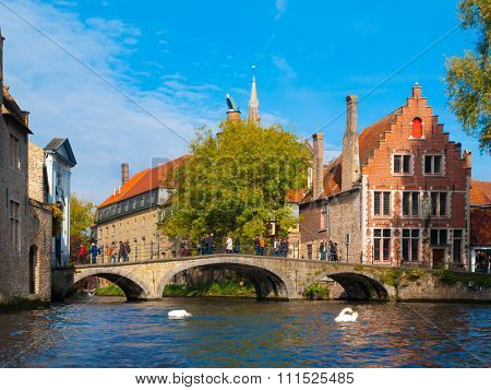 Water canal with old bridge and medieval houses of Bruges