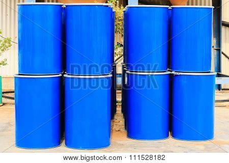 Four Stack Of Blue Barrels