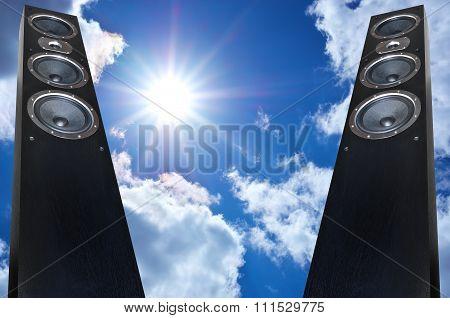 Pair Of Black Music Speakers On Deep Blue Sky Background