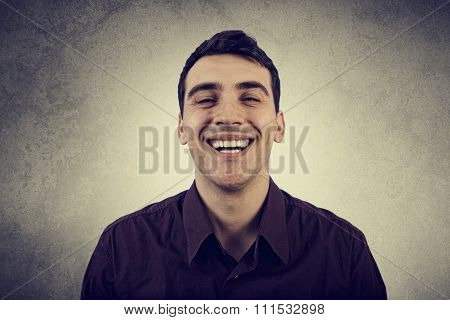 Fake smile.Young man smiles falsely.