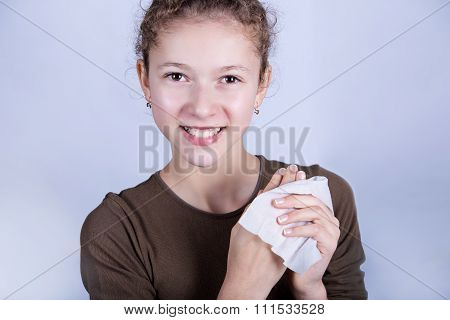 Child Hygiene.Little girl cleaning her hands with a wet baby wipe