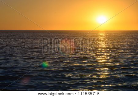 Sunset Above The Ocean With Lens Flares