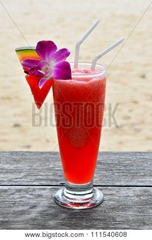 Glass Of Watermelon Fresh Juice On Beach
