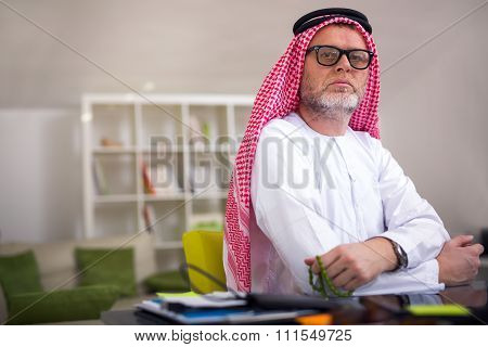 Arabian business man in his home office