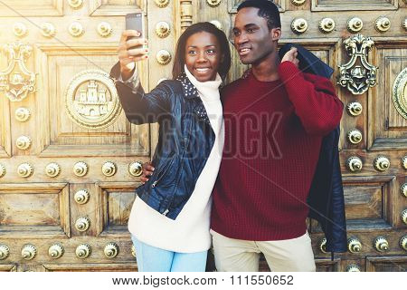 Man and woman tourist photographing themselves for social network picture
