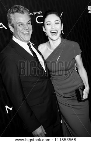 Danny Huston and Olga Kurylenko at the Los Angeles premiere of Starz Series 'Magic City' held at the DGA Theater in Hollywood, USA on March 20, 2012.