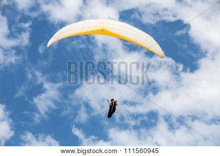 Amateur Paraglider In Blue Cloudy Sky