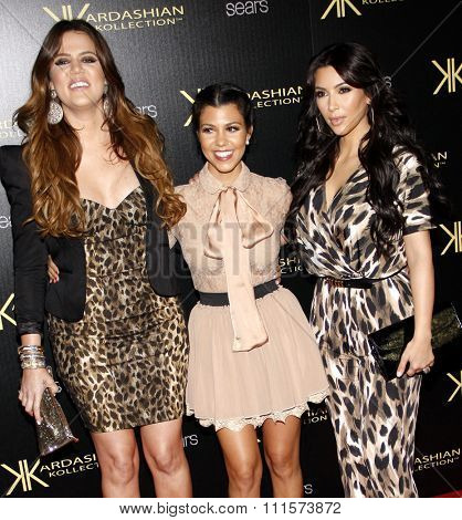 HOLLYWOOD, CA - AUGUST 17, 2011: Khloe Kardashian, Kourtney Kardashian and Kim Kardashian at the Kardashian Kollection Launch Party held at the Colony in Hollywood, USA on August 17, 2011.