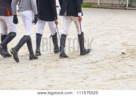 Riders Walking A Course At Horse Jumping Competition