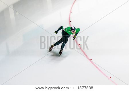 General plan man athlete skater on track sprint races