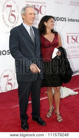 Clint Eastwood and Dina Ruiz at the 75th Diamond Jubilee Celebration for the USC School of Cinema-Television held at the USC's Bovard Auditorium in Los Angeles, USA on September 26, 2004.