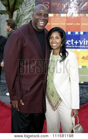 HOLLYWOOD, CA - JULY 15, 2004: Magic Johnson and Cookie Johnson at the World premiere of 'The Bourne Supremacy' held at the ArcLight Cinema in Hollywood, USA on July 15, 2004.