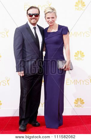 LOS ANGELES, CA - AUGUST 25, 2014: Ricky Gervais and Jane Fallon at the 66th Annual Primetime Emmy Awards held at the Nokia Theatre L.A. Live in Los Angeles, USA on August 25, 2014.
