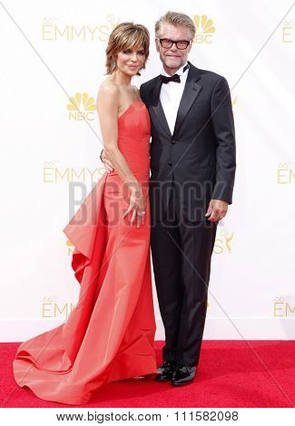 LOS ANGELES, CA - AUGUST 25, 2014: Harry Hamlin and Lisa Rinna at the 66th Annual Primetime Emmy Awards held at the Nokia Theatre L.A. Live in Los Angeles, USA on August 25, 2014.