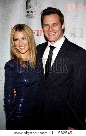 HOLLYWOOD, CA - MARCH 08, 2010: Travis Schuldt and Natalie Zea at the premiere screening of FX's 'Justified' held at the DGA Theater in Hollywood, USA on March 8, 2010.