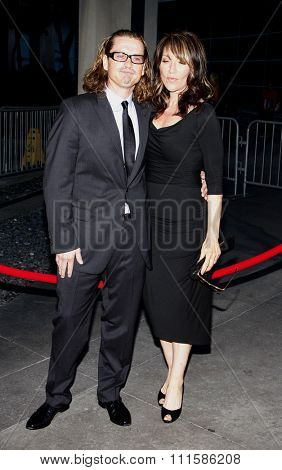 HOLLYWOOD, CALIFORNIA - August 30, 2011. Kurt Sutter and Katey Sagal at the Season 4 premiere of FX Network's