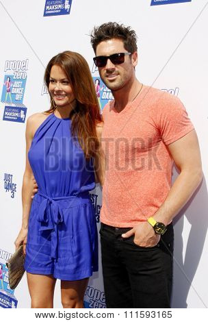 Maksim Chmerkovskiy and Brooke Burke at the Propel Zero Just Dance Off held at the Jimmy Kimmel Live! Studio Lot in Hollywood, USA on April 29, 2012.