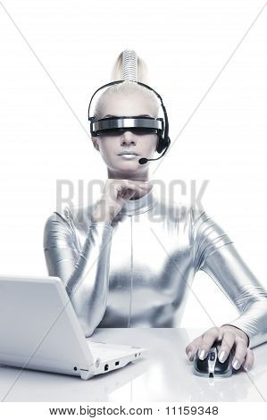 Beautiful cyber woman working on her laptop