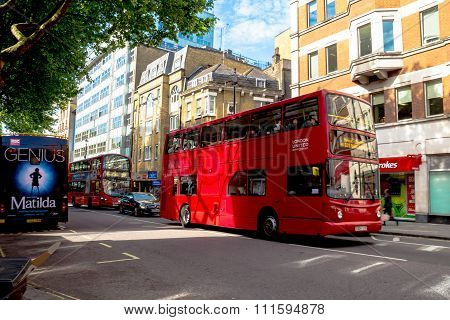 Double-decker Bus At The Center Of London