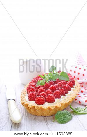 pie tart with raspberries on a white background