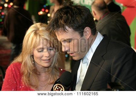 Jann Carl and Ben Affleck at the Los Angeles premiere of 'Surviving Christmas' held at the Grauman's Chinese Theatre in Hollywood, USA on October 14, 2004.