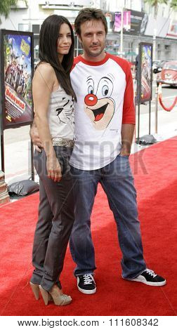 HOLLYWOOD, CALIFORNIA. July 30, 2006. Courteney Cox and husband David Arquette attend the World Premiere of