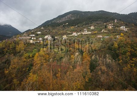 Scenic Mountain Autumn Landscape And Village Prusos