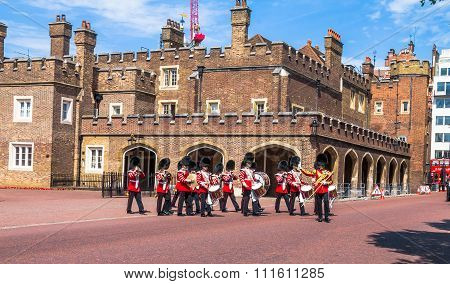 British Guardsmen March Down Opposite St. James Palace. The Mall. London. Uk