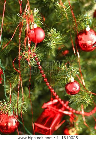 Red Glass Balls Decorate A Christmas Tree