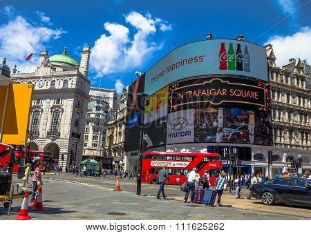 View of Piccadilly Circus with unidentified tourists and locals in London.