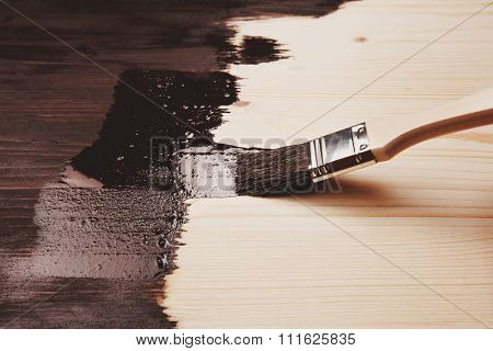 Painting wood with paint brush