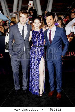 Taylor Lautner, Robert Pattinson and Kristen Stewart at the Los Angeles premiere of 'The Twilight Saga: Breaking Dawn Part 1' held at the Nokia Theatre in Los Angeles, USA on November 14, 2011.