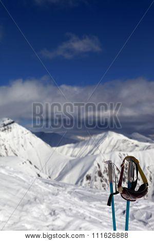 Ski Mask On Ski Poles In Snowy Mountain