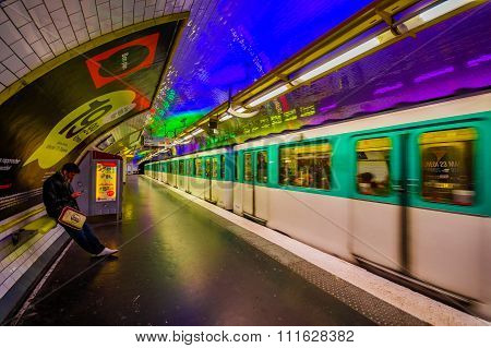 Train moving in parisian subway Metro station, France