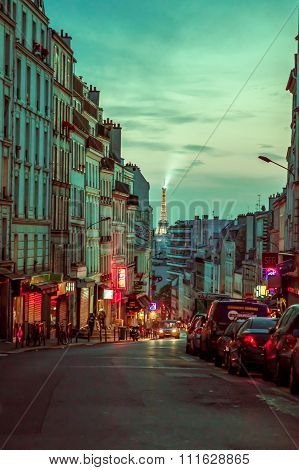 Beautiful and colorful parisian city street scene with Eiffel Tower in the background