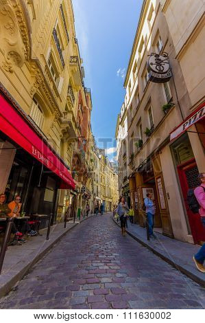 Charming narrow street in the Latin quartier area of Paris, France